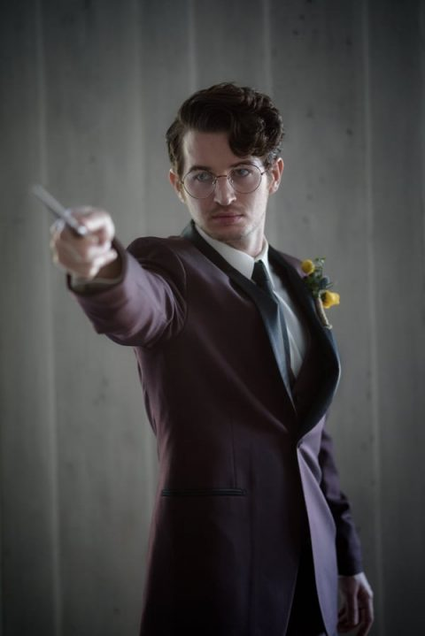 a Harry Potter-inspired groom_s look with a burgundy tux and those glasses