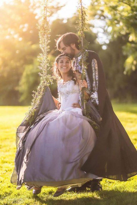 a Lord Of the Rings inspired marrying couple in the costumes that remind of the films