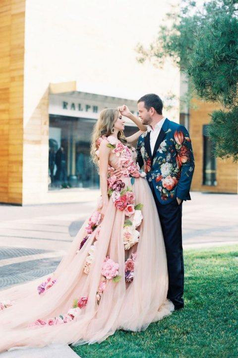 a blush princess style wedding dress with large faux blooms all over