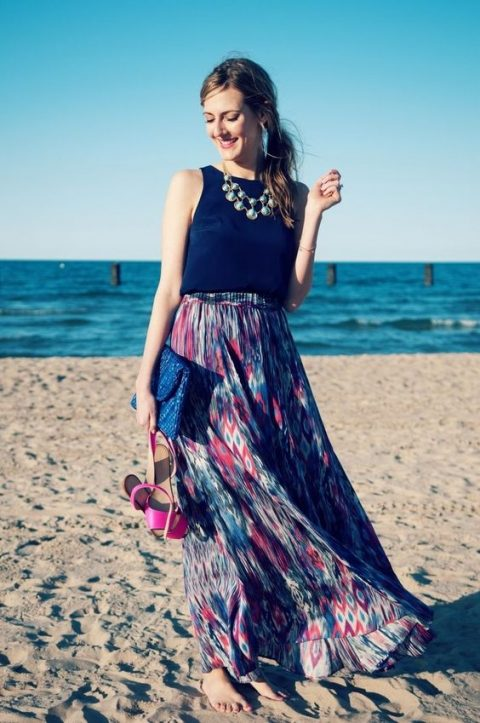 a bold look with a navy sleeveless top, a colorful printed maxi skirt, a blue clutch and pink shoes
