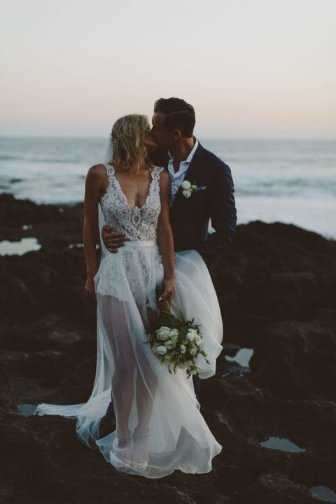 a bold modern wedding dress with a lace bodysuit and a sheer skirt