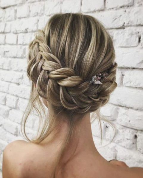 a braided updo with some locks down and a small hairpiece for an accent