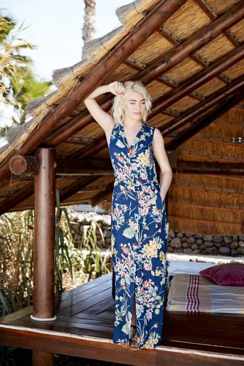 a bright navy maxi dress with a floral print, a front slit, a V-neckline and no sleeves