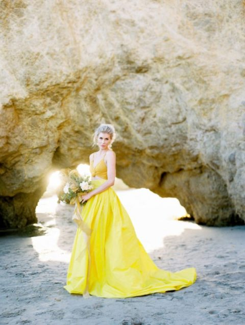 a colorful bridal separate with a mustard crop top and a bright yellow maxi skirt with a train