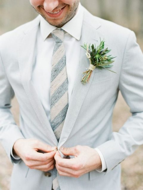 a dove grey suit, a white shirt and a striped tie