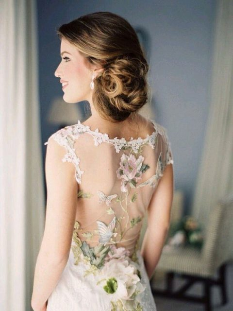 a fantastic wedding dress with an illusion back decorated with butterfly, bird and floral appliques by Claire Pettibone