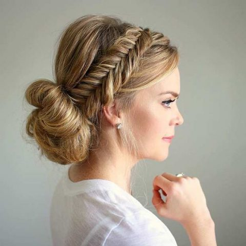 a fishtail braid halo with a low bun and a bump