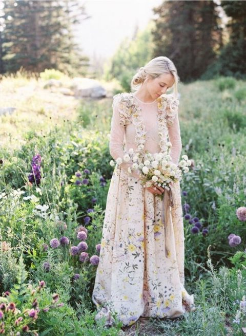 a floral print wedding dress with faux flower decor on the bodice