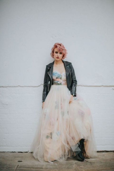 a floral strapless wedding gown, a black leather jacket and black boots