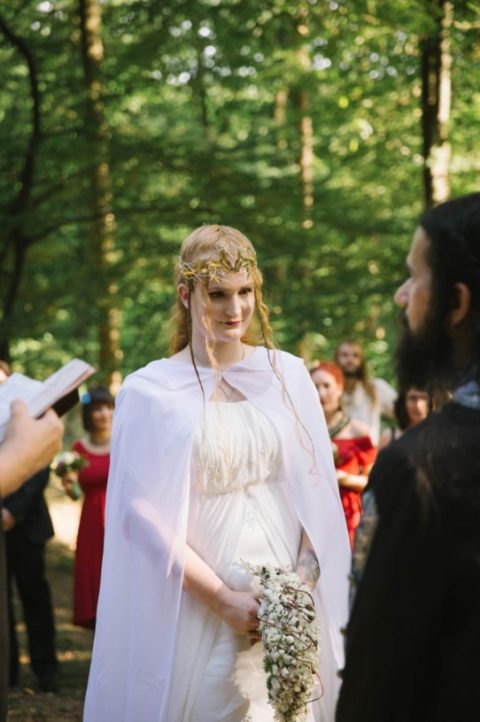 a flowy light dress and a cap, a perfect elvish headpiece and a braided half updo