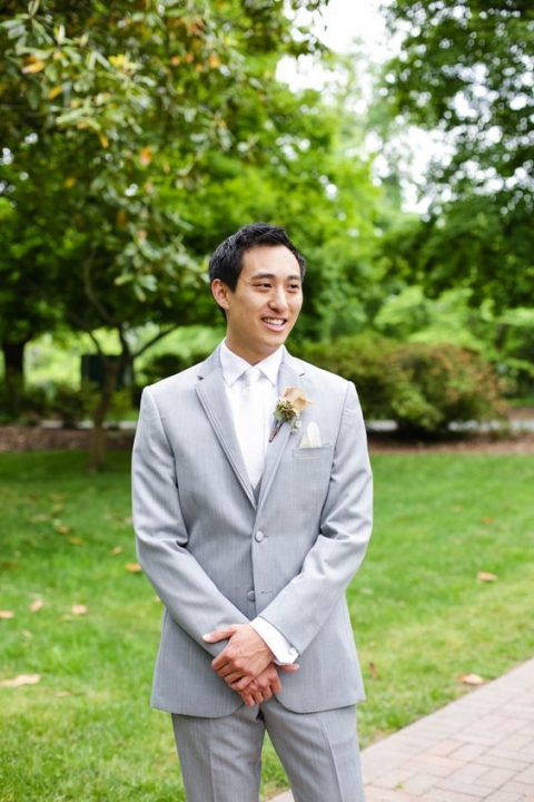 a grey suit paired with a white shirt and a white tie for a fresh spring look