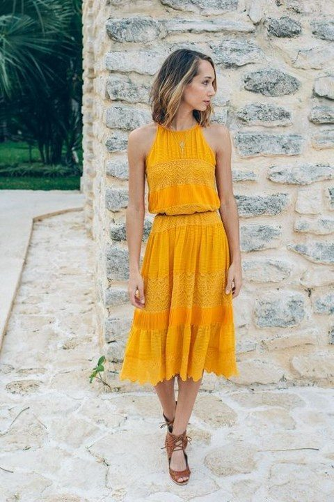 a lac ehalter neckline midi dress and strappy brown shoes