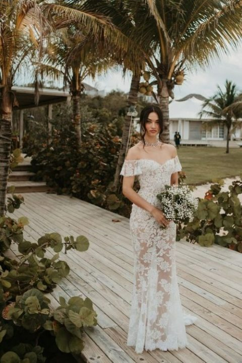 a lace off the shoulder fitting wedding dress for a romantic bride