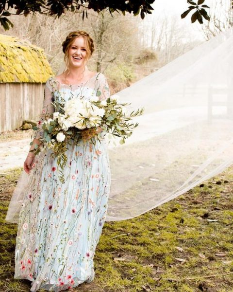 a light blue floral embroidery wedding dress with long sleeves for a summer bride