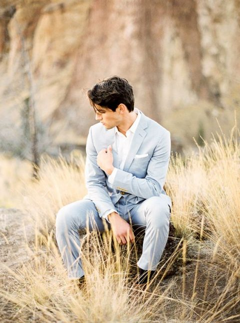 a light blue suit, a white shirt and no tie for a more relaxed look