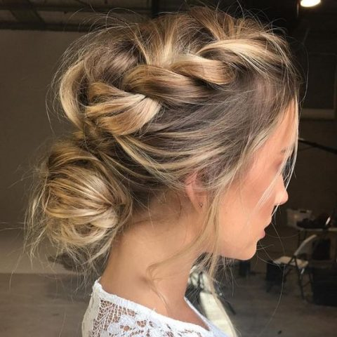 a messy braided low bun updo for a modern and trendy look
