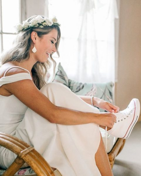 a modern bride wearing Converse wedge sneakers so that she could dance all night long