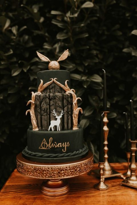 a moody Harry Potter wedding cake in black and gold inspired by Patronum