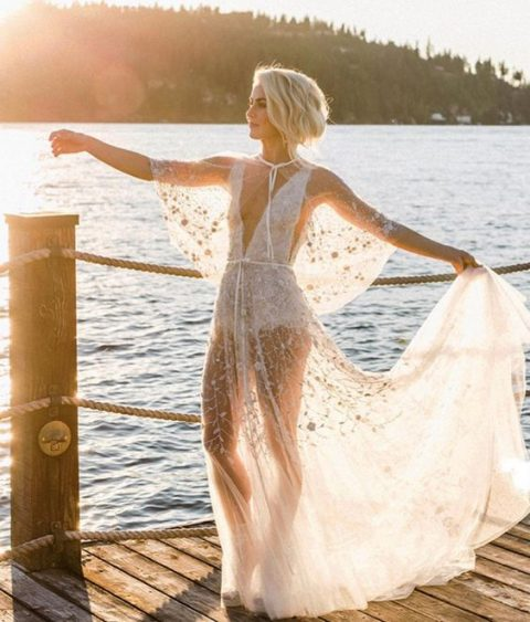a naked wedding gown with floral embroidery and a white bodysuit underneath