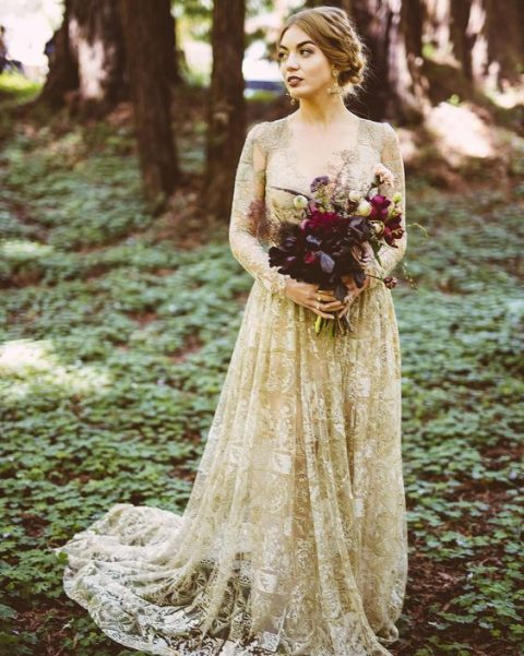 a nude and gold lace wedding dress with long sleeves just wows