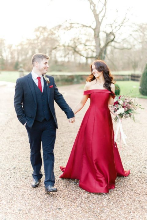 a red off the shoulder A-line wedding gown with a train for a Christmas wedding