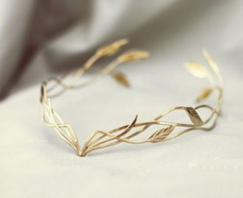 a refined and airy elvish wedding headpiece with leaves