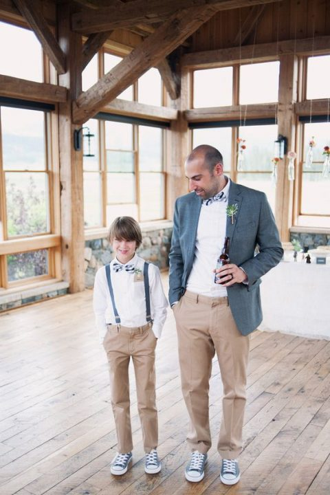 a relaxed groom_s look with a grey blazer, tan pants, a white shirt and striped bow tie, blue sneakers