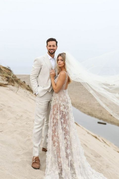a romantic lace applique wedding dress with a cutout back and a long train