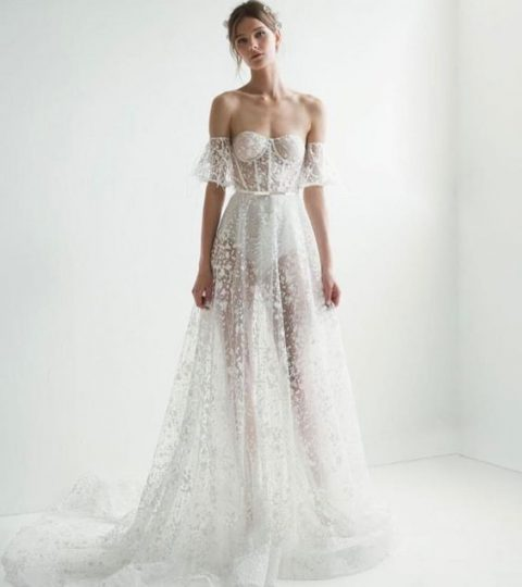 a sheer lace off the shoulder wedding dress with a bustier looks ethereal