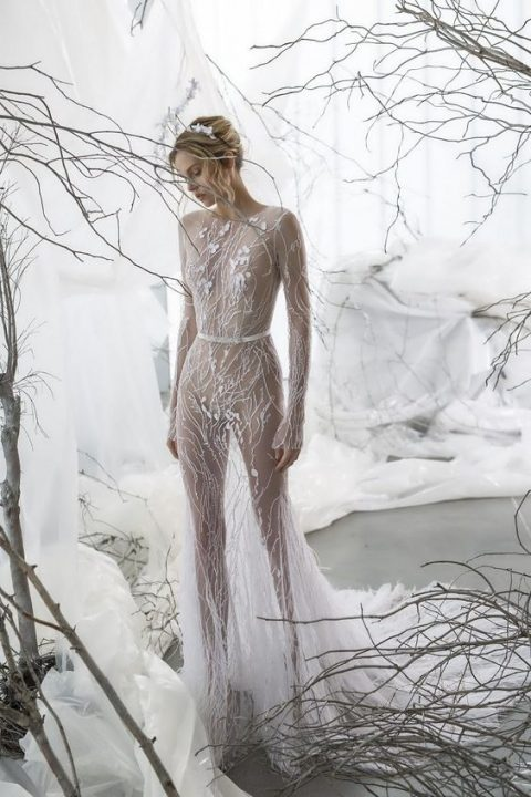 a sheer wedding gown by Mira Zwillinger, with embroidery and petal appliques
