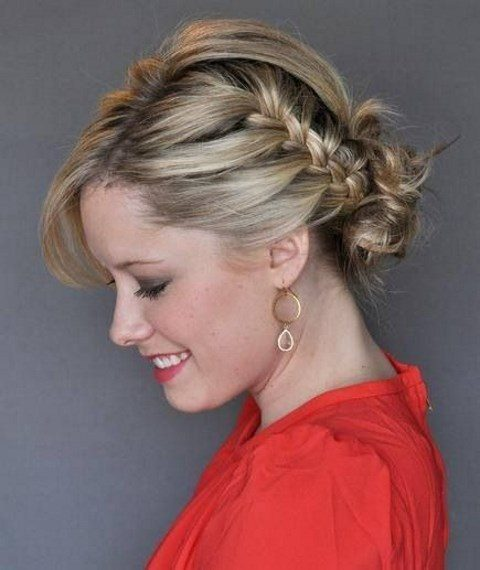 a side French braid into a low bun