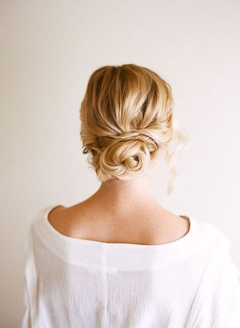 a simple twisted low bun is suitable for long and medium length hair