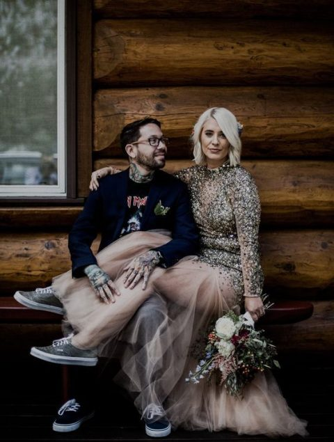 a sparkling wedding dress with a gold sequin bodice and a sheer skirt