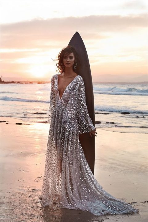a stunning plunging neckline wedding dress with bell sleeves fully covered with silver sequins