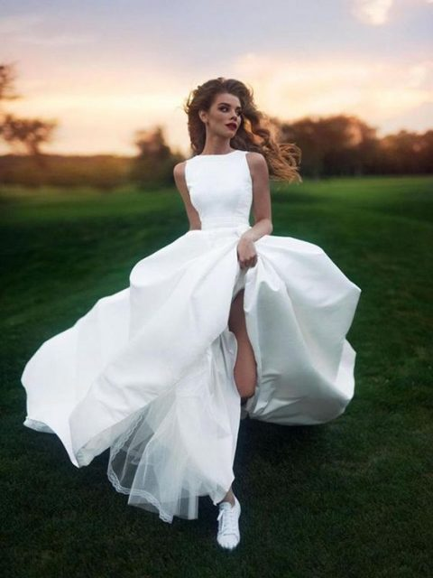 a super modern bridal look with a plain A-line wedding gown and white sneakers