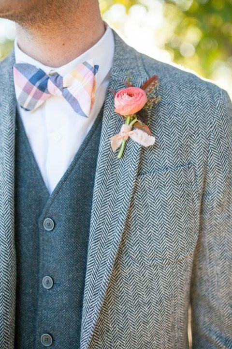 a tweed suit with a vest, a striped colorful bow tie