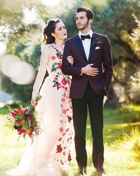 a unique lace wedding dress with long sleeves and floral embroidery
