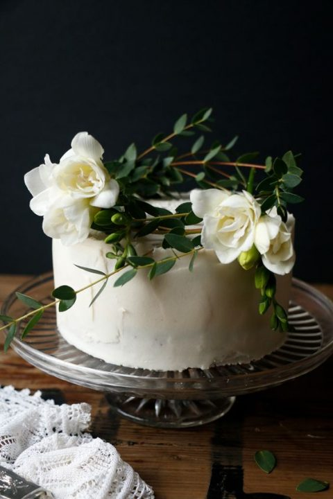 a vegan gluten-free apple wedding cake with macadamia frosting and salted caramel