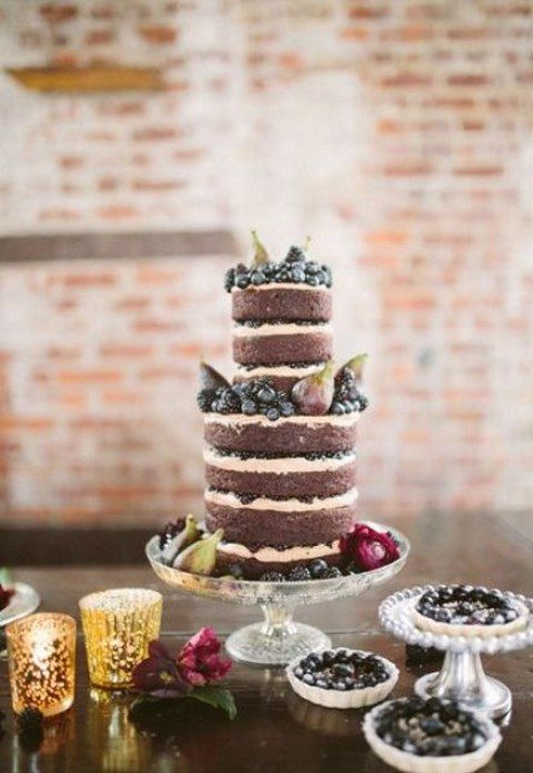a vegan gluten-free naked chocolate wedding cake with espresso icing and fresh blackberries and figs