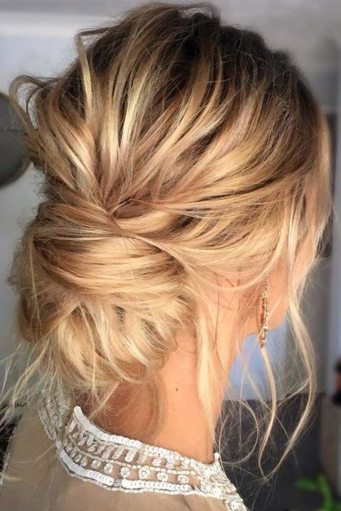 a very messy updo with a low bun and locks down