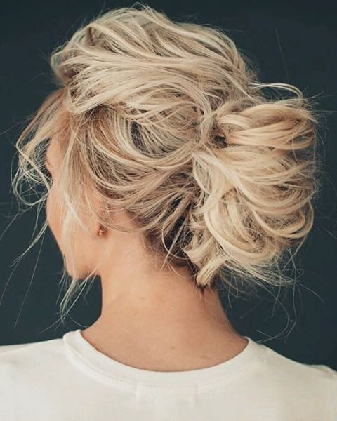 a very messy updo with twists and locks down for short hair