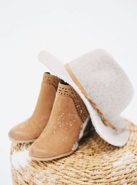 amber laser cut wedding boots and a hat with a matching ribbon