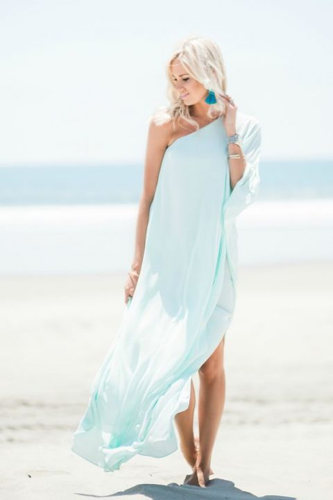 an aqua maxi one shoulder dress with turquoise statement earrings