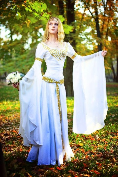 an elvish wedding dress in ombre blue with embroidery