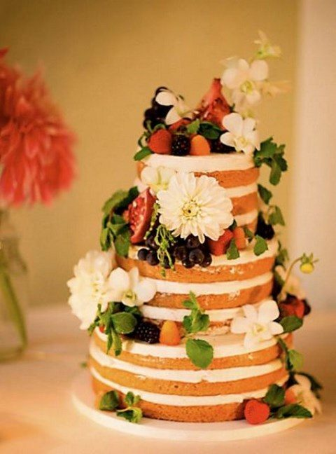 an organic vegan and gluten-free orange blossom wedding cake with lemon curd and vanilla bean cream plus fresh blooms