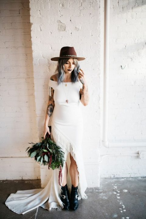 black leather boots with buckles paired with an off the shoulder fringe wedding dress and a hat
