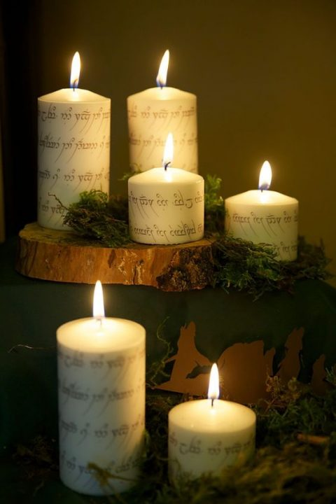 candles decorated with elvish words look really magical