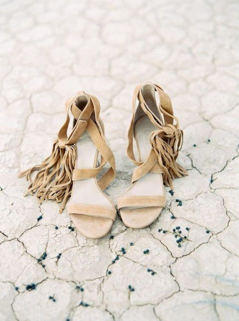 nude strappy wedding heels with long fringe will make your look free-spirited