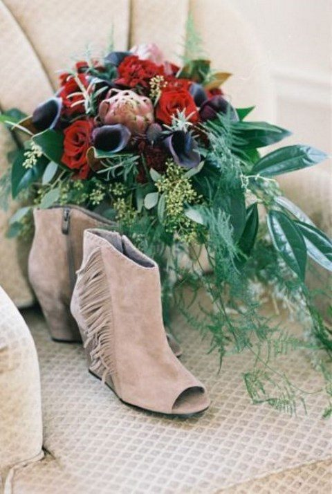 nude suede peep toe boho booties with long fringe on the sides look very wild and kinda cowboy