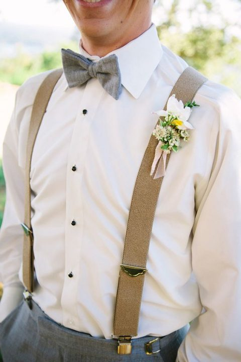 tan suspenders, a gret bow tie and a shirt with black buttons
